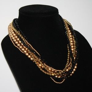 Beautiful vintage gold and black beaded necklace
